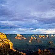 The rock formations of the Grand Canyon are bathed in the first light, as a new day dawns on the South Rim.