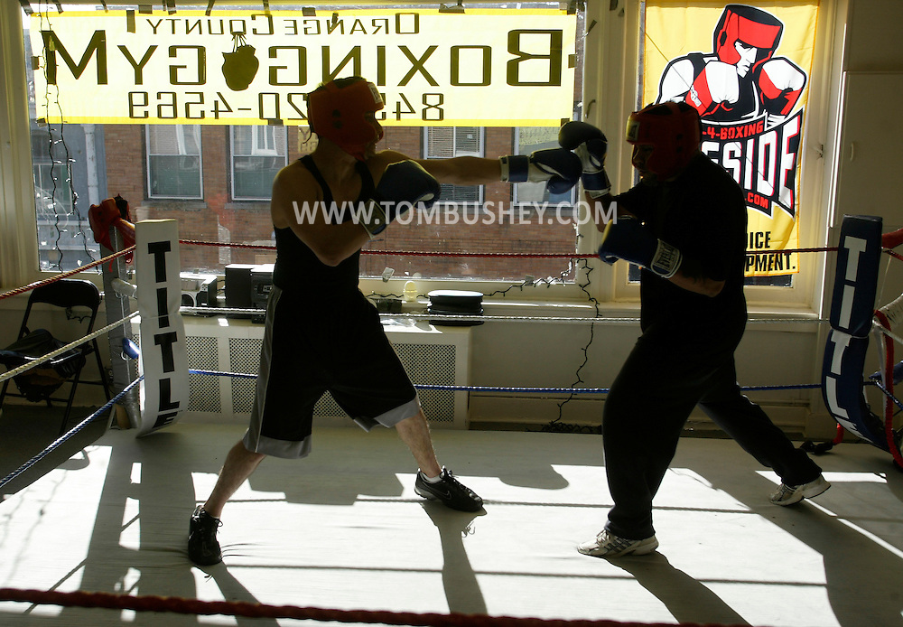 Manny Guzman, left, spars with Aramis Cabrera at the Orange County Boxing Club in Middletown on April 19, 2007.