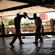 The Hillbrow Boxing Club is a former petrol station turned into a boxing club that accommodates an open-air boxing ring and a gym on the inside. It is a haven in this neighbourhood considered a no-go area for many inhabitants of Johannesburg.