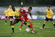 Whitehawk striker Danny Mills battles with Ebbsfleet Anthony Acheampont during the National League South Play Off 1st Leg match between Whitehawk FC and Ebbsfleet United at the Enclosed Ground, Whitehawk, United Kingdom on 4 May 2016. Photo by Phil Duncan.
