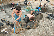 Jean Godert (left) and other members of the team digging at the palaeontological excavations at Angeac, Charente, France (July 2016) © Rudolf Abraham