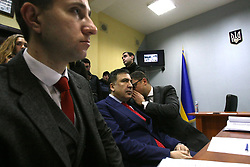 February 5, 2018 - Kyiv, Ukraine - Rukh Novykh Syl (Movement of New Forces) Party leader Mikheil Saakashvili (C) listens to his lawyer Ruslan Chornolutskyi during a hearing into his appeal against the decision of the State Migration Service to deny the status of a refugee or a person in need on additional protection at the Kyiv Administrative Appeal Court, Kyiv, capital of Ukraine, February 5, 2018. Ukrinform...KYIV. Rukh Novykh Syl (Movement of New Forces) Party leader Mikheil Saakashvili has attended a hearing of the Kyiv Administrative Appeal Court into his appeal against the decision of the State Migration Service denying him the status of a refugee or a person in need on additional protection. (Credit Image: © Ovsyannikova Yulia/Ukrinform via ZUMA Wire)