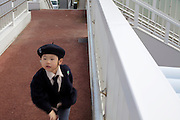 preschool child in uniform running home Japan