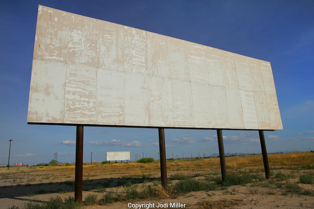 Blank billboards in an empty field