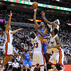 Jun 17, 2012; Miam, FL, USA; Oklahoma City Thunder small forward Kevin Durant (35) shoots over Miami Heat small forward LeBron James (6) as small forward Shane Battier (31), shooting guard Mike Miller (13), and power forward Udonis Haslem (40) close in on defense during the first quarter in game three in the 2012 NBA Finals at the American Airlines Arena. Mandatory Credit: Derick E. Hingle-US PRESSWIRE