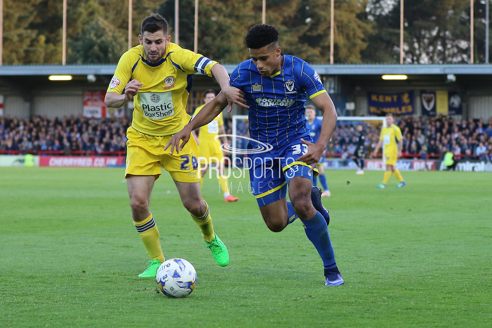 Lyle Taylor forward for AFC Wimbledon (33) and Seamus Conneely midfielder Accrington Stanley (28) battle during  the Sky Bet League 2 Play-Off first leg match between AFC Wimbledon and Accrington Stanley at the Cherry Red Records Stadium, Kingston, England on 14 May 2016. Photo by Stuart Butcher.