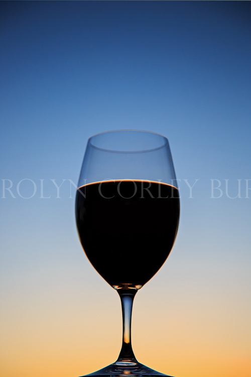 Silhouette of wine glass at sunset.