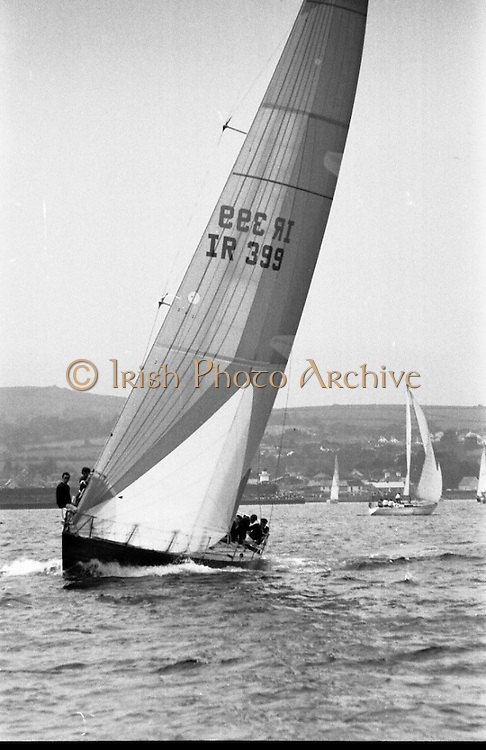 Round Ireland Yacht Race.  (R81)..1988..18.06.1988..06.18.1988..18th June 1988..The Round Ireland Yacht Race set sail from Wicklow today. Yachts from all over Europe took part in the start as the race got underway. The race is sponsored by Cork Dry Gin...Image shows the yacht 'Moonduster' heading to the start line of the Round Ireland Race. 'Moonduster' is the Cork Dry Gin Round Ireland Record Holder.