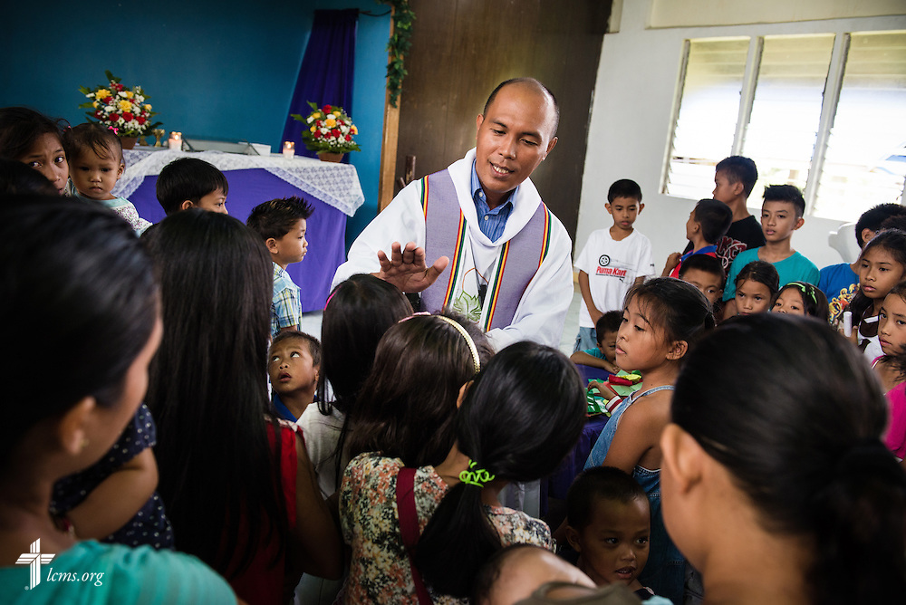 Pastor Xavier James Palattao blesses children during worship at Christ Lutheran Church in Mahayag, Leyte Province, Philippines, on Sunday, March 16, 2014. LCMS Communications/Erik M. Lunsford