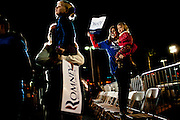 Supporters cheer at a campaign rally for GOP presidential candidate Mitt Romney in Henderson, Nevada strip mall, February 3, 2012.