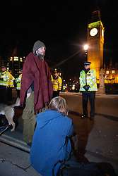 © licensed to London News Pictures. London, UK 16/01/12. Protesters are waiting on the pavement after their protest camp in London's Parliament Square has been cleared by police last night (16/01/12). Photo credit: Tolga Akmen/LNP