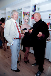Left to right, sculptor DAVID WYNNE, LADY BIENVENIDA BUCK and STEVEN BERKOFF at a reception to celebrate the repairs on the Queen Elizabeth Gate in Hyde Park after it's successful repair following damaged sustained in a traffic accident in early 2010.  The party was held at 35 Sloane Gardens, London on 7th June 2010.
