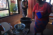 "6 March 2009, Evaton, South Africa. Mantwa Mbele brews ""umqombothi"" - a home-made alcoholic beverage made from maize meal, sorghum, brown sugar and brown flour. This is sold clientele from the neighbourhood."