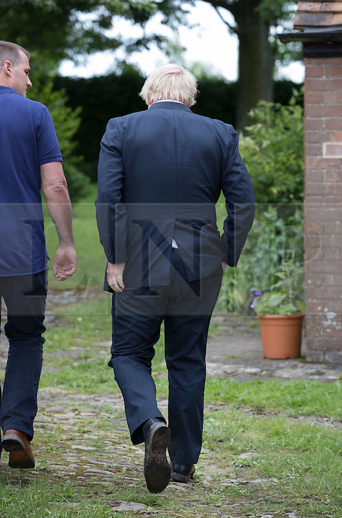 © Licensed to London News Pictures. 26/06/2016. Oxfordshire, UK. Boris Johnson walks with Jake Berry MP at his home in Oxfordshire. Prime Minister David Cameron his holding a cabinet meeting tomorrow after announcing his resignation on Friday. The United Kingdom has voted to leave the EU in an historic referendum.  Photo credit: Peter Macdiarmid/LNP