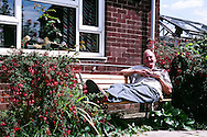Graham Burton, outside his neighbour prefab, 2005.<br /> Post-war prefabs in Chesterfield and North Wingfield, Derbyshire, 2005