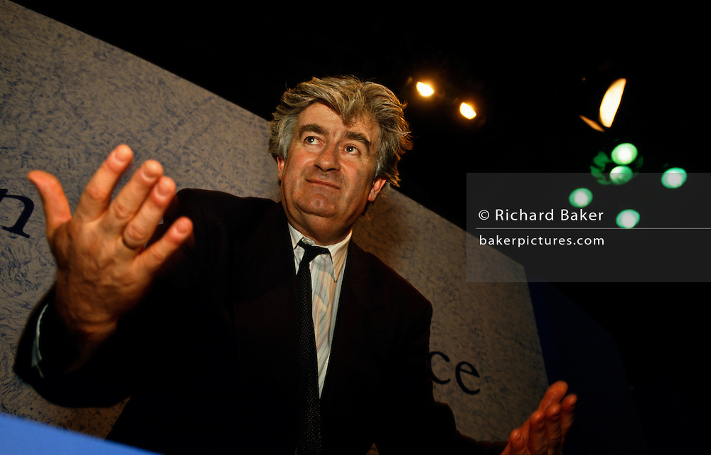 Serb politician Radovan Karadzic is seen leaning over to address the London Conference in 1992 when peace-makers attempted to diffuse the Bosnian European conflict. As one of the world's most wanted men, Karadzic was eventually arrested after 12 years on the run to face charges of genocide and crimes against humanity inflicted on Bosnian Muslim, Bosnian Croat and other non-Serb civilians in Bosnia and Herzegovina during the 1992-95 war, when he was president of the breakaway Republika Srpska. Implicated in the murder of nearly 8,000 Bosnian Muslim men and boys in Srebrenica, after the supposedly UN-protected enclave fell to Bosnian Serb forces. The former psychiatrist and aspiring poet is also charged with running death camps for non-Serbs, and the shelling and sniping on civilians in the Bosnian capital, Sarajevo, in a siege that lasted more than three years. UPDATE MARCH 2016 Former Bosnian Serb leader Radovan Karadzic was convicted of genocide and war crimes over the 1992-95 war, and sentenced to 40 years in jail. UN judges in The Hague found him guilty of 10 of 11 charges, including genocide over the 1995 Srebrenica massacre.