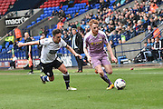 Reading Midfielder,  Stephen Quinn breaks from Bolton Wanderers Forward, Zach Clough during the Sky Bet Championship match between Bolton Wanderers and Reading at the Macron Stadium, Bolton, England on 2 April 2016. Photo by Mark Pollitt.