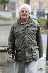 © Licensed to London News Pictures. 02/12/2014. London, UK. Peace campaigner, John Catt arrives at the Supreme Court in London on 2nd December 2014. In 2013, judges at the Court of Appeal ruled in favour of Catt who fought to have his personal details about attendance at various protests and demonstrations against the arms trade removed from a police extremism database, but police are challenging that decision at the UK's highest court, the Supreme Court. Photo credit : Vickie Flores/LNP