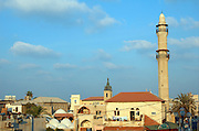 Israel, Jaffa, the turret of Muhamidiya mosque AKA great mosque old Jaffa with the Ottoman clock tower in the background August 2005