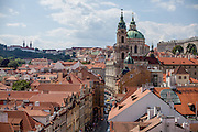 "View from a tower at the end of Charles Bridge to Mostecka street and the ""Lesser Town"" (Mala Strana). In the back the Church of Saint Nicolas."