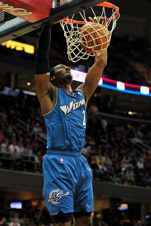 April 13, 2011; Cleveland, OH, USA; Washington Wizards point guard John Wall (2) dunks during the first quarter against the Cleveland Cavaliers at Quicken Loans Arena. Mandatory Credit: Jason Miller-US PRESSWIRE