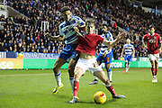 Bristol City midfielder Joe Bryan and Reading forward Nick Blackman during the Sky Bet Championship match between Reading and Bristol City at the Madejski Stadium, Reading, England on 2 January 2016. Photo by Jemma Phillips.