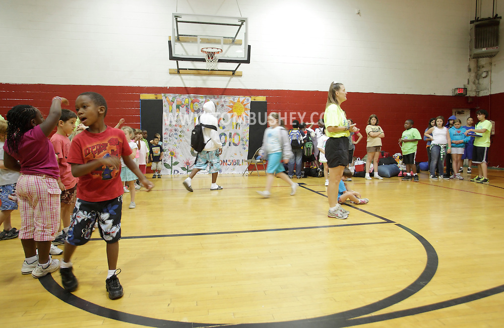 Middletown, New York - Children gather in the gymnasium in the morning at the start of  the day at Middletown YMCA summer camp on August 20, 2010.