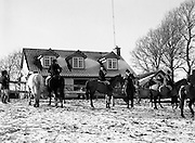 Hunt meets at Brittas, Co Dublin.    (K85)..1977..29.01.1977..01.29.1977..29th January 1977..A new year hunt meet was held today at Brittas,Co Dublin.The hunt started at Brittas Lodge..With the lodge in the background image shows riders preparing to start the Brittas Hunt.