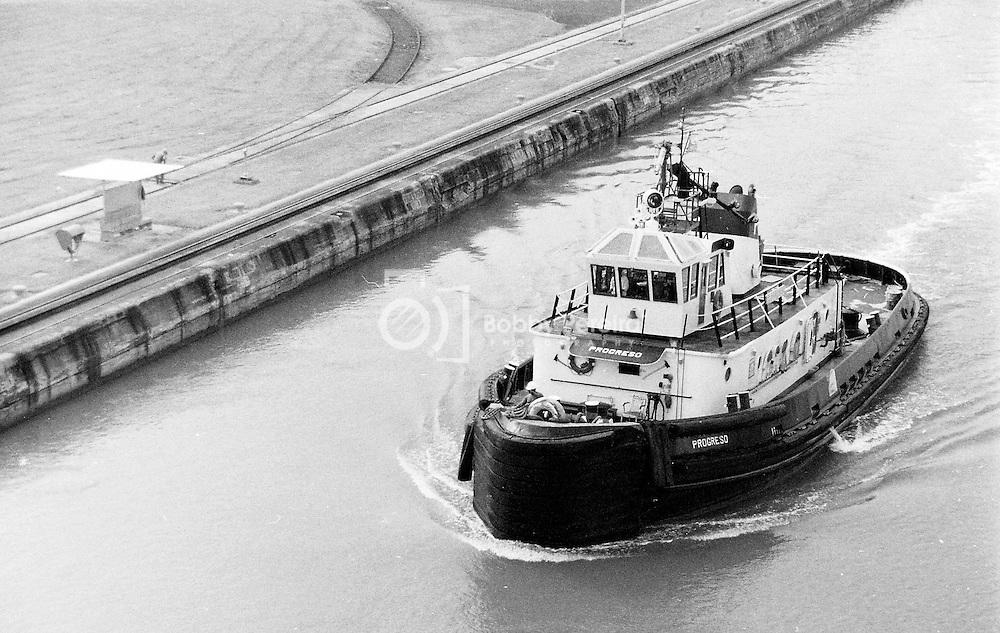 Tugboat entering the Miraflores Locks at the Panama Canal.