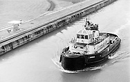 Tugboat entering the Miraflores Locks at the Panama Canal.