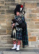 Bagpiper in Highland dress, including kilt (or trews), tartan (plaid in North America), and sporran. Edinburgh, capital of Scotland, UK, Europe.