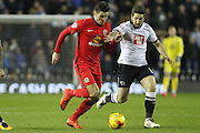 Blackburn Rovers midfielder Ben Marshall and Derby County midfielder Jacob Butterfield challenge for the ball during the Sky Bet Championship match between Derby County and Blackburn Rovers at the iPro Stadium, Derby, England on 24 February 2016. Photo by Aaron  Lupton.