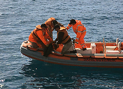 Members of the Turkish coast guard search on the Aegean Sea, Turkey, on March 6, 2016. At least 18 refugees drowned on Sunday when two boats capsized off Turkey's Aegean coast while attempting to reach a Greek Island, Turkish media reported. EXPA Pictures © 2016, PhotoCredit: EXPA/ Photoshot/ Merit Macit<br /> <br /> *****ATTENTION - for AUT, SLO, CRO, SRB, BIH, MAZ, SUI only*****