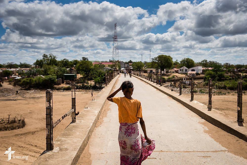 A woman walks on the bridge over the dry Manambovo River in Tsiombe, southern Madagascar, on Tuesday, Oct. 21, 2014.  LCMS Communications/Erik M. Lunsford