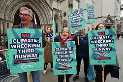 © Licensed to London News Pictures. 15/01/2019. London, UK.  Demonstrators stage a protest opposing the government's plans for a third runway at Heathrow Airport outside the Royal Courts of Justice. A pre-trial hearing challenging the legality of the government's decision takes place today with campaigners claiming the decision is unlawful as it ignores climate impact.  Photo credit: Vickie Flores/LNP