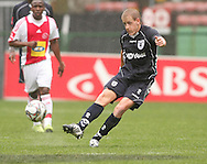 Michael Morton crosses  during the PSL match between Ajax Cape Town and Bidvest Wits held at Newlands Stadium in Cape Town on 13 September2009 ..Photo by Shaun Roy/www.sportzpics.net.+27 21 785 6814..