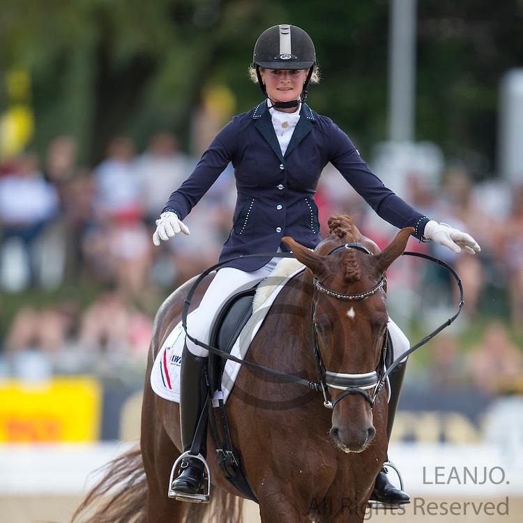 Marieke van der Putten - Vitalis<br /> FEI World Breeding Dressage Championships for Young Horses 2012<br /> © DigiShots
