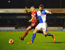 Bristol Rovers' Matt Harrold battles with a Crawley defender - Photo mandatory by-line: Seb Daly/JMP - Tel: Mobile: 07966 386802 08/01/2014 - SPORT - FOOTBALL - Broadfield Stadium - Crawley - Crawley Town v Bristol Rovers - FA Cup - Replay