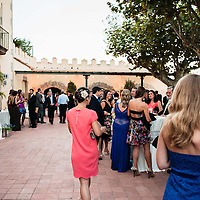 A woman walks across the courtyard at a wedding in Castell de l'Oliver, Sant Vicenç de Montalt, Maresme, Barcelona,