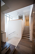 Staircase leads to guest quarters and open loft office