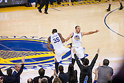 Golden State Warriors guard Stephen Curry (30) and forward Kevin Durant (35) celebrate after hitting a three pointer against the LA Clippers at Oracle Arena in Oakland, Calif., on February 23, 2017. (Stan Olszewski/Special to S.F. Examiner)