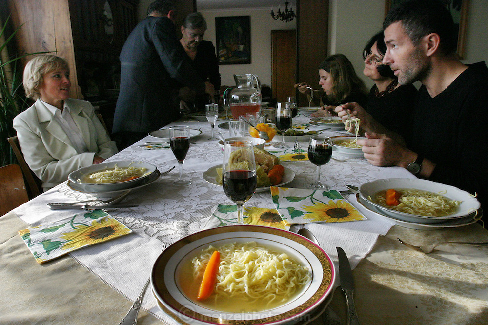 In the farmhouse dining room in the village of Adamka, in central Poland, 93-year-old Maria Kwiatkowska, Borys's grandmother, serves her family dinner in honor of All Saints Day in Poland. (Supporting image from the project Hungry Planet: What the World Eats.)