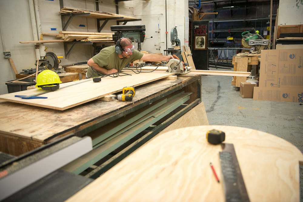 Chris Eichler helps contruct a set for Tantrum Theater. Photo by Ben Siegel