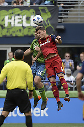 May 26, 2018 - Seattle, Washington, U.S - MLS Soccer 2018: Seattle's CHAD MARSHALL (14) and RSL's DAMIR KREILACH (6) go up to head the ball as Real Salt Lake visited the Seattle Sounders in a MLS match at Century Link Field in Seattle, WA. RSL won the match 1-0. (Credit Image: © Jeff Halstead via ZUMA Wire)