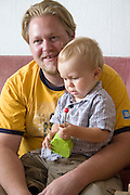 Dad in conversation while son operates remote for new automated car ages 32 and 1. Balucki District Lodz Central Poland