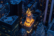 Aerial view of the Crown Building on Fifth Avenue in New York City, photographed at dusk from a helicopter.