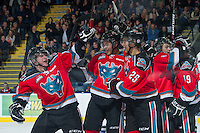KELOWNA, CANADA - DECEMBER 5: Cody Fowlie #18, Madison Bowey #4, Colton Heffley #25, Cole Martin #8 and Dylen McKinlay #19 celebrate a goal against the  Swift Current Broncos at the Kelowna Rockets on December 5, 2012 at Prospera Place in Kelowna, British Columbia, Canada (Photo by Marissa Baecker/Shoot the Breeze) *** Local Caption ***