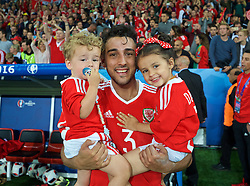 LILLE, FRANCE - Friday, July 1, 2016: Wales' Neil Taylor celebrates with his children after the 3-1 victory over Belgium during the UEFA Euro 2016 Championship Quarter-Final match at the Stade Pierre Mauroy. (Pic by David Rawcliffe/Propaganda)