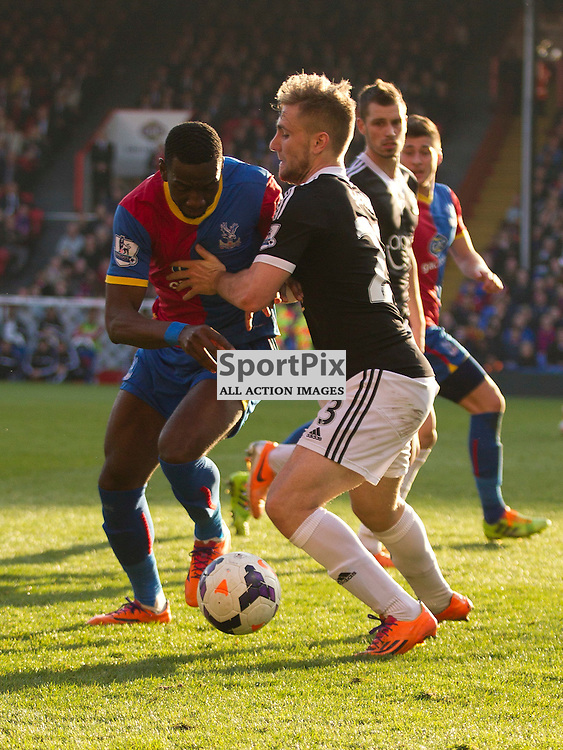Maya Yoshida gets physical with Yannick Bolasie with Crystal Palace v Southampton Premiership  Premiership 8/3/2014 (c) Steve Ball|/Sportpix.org.uk(c) Steve Ball| SportPix.org.uk