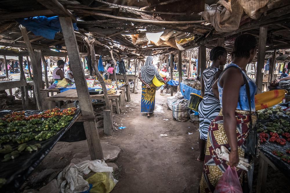 Women walk through the market in Ganta, Liberia